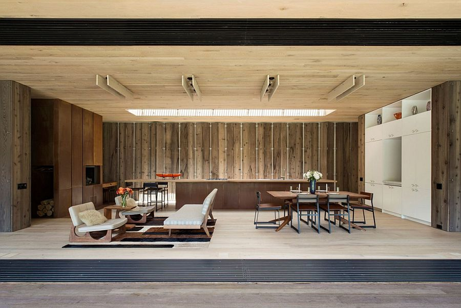 Wide cedar board siding becomes a part of the interior at this acoutically sound New York home