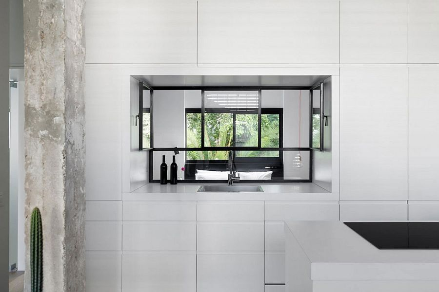 Window in the kitchen cabinets allows for passage of natural light into the bedroom