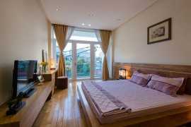 Wooden bed and headboard in the modern bedroom feel like an extension of the floor