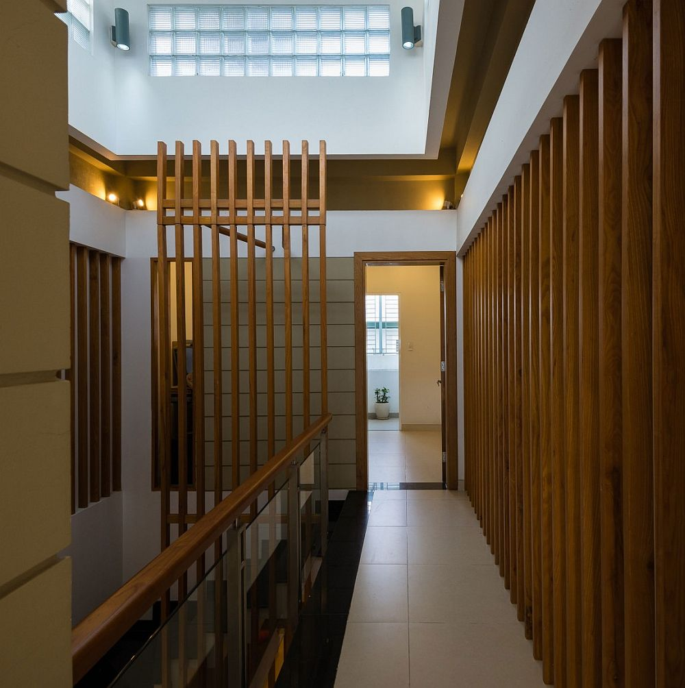 Wooden slats combine privacy and demarcation of space with smart flow if light