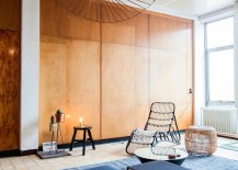 Wooden walls bring texture to the ligh-filled living space