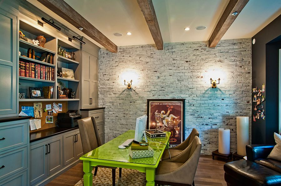 Work desk adds color to the contemporary home office with brick wall [Design: Jill Wolff Interior Design]