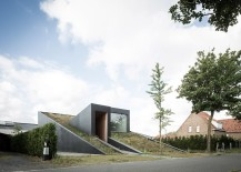 A view of the underground split level house with a green roof 217x155 House Pibo: Partially Underground Home Turns Its Roof into an Extended Garden!