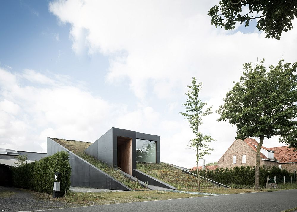 A view of the underground split-level house with a green roof