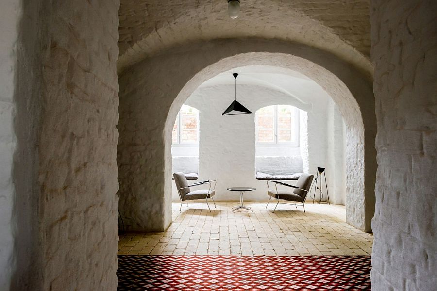 Archways and arching windows give the interior a cool, Mediterranean vibe