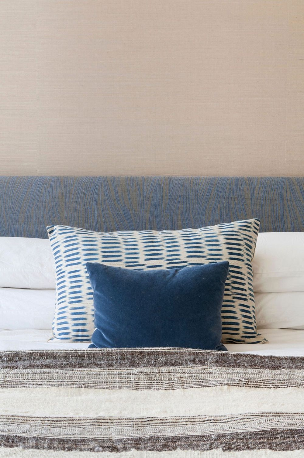 Bedroom with grasscloth walls and blue accents