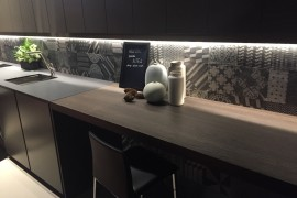 Bespoke backsplash in kitchen made with a variety of tiles looks great as it is!