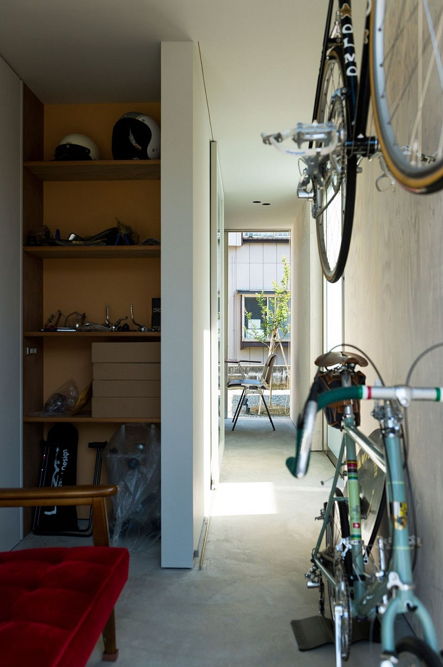 Bicycles and bikes become a decorative part of interior at the Go Bang! House