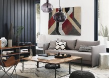 Black vertical wall paneling in a room designed by CB2