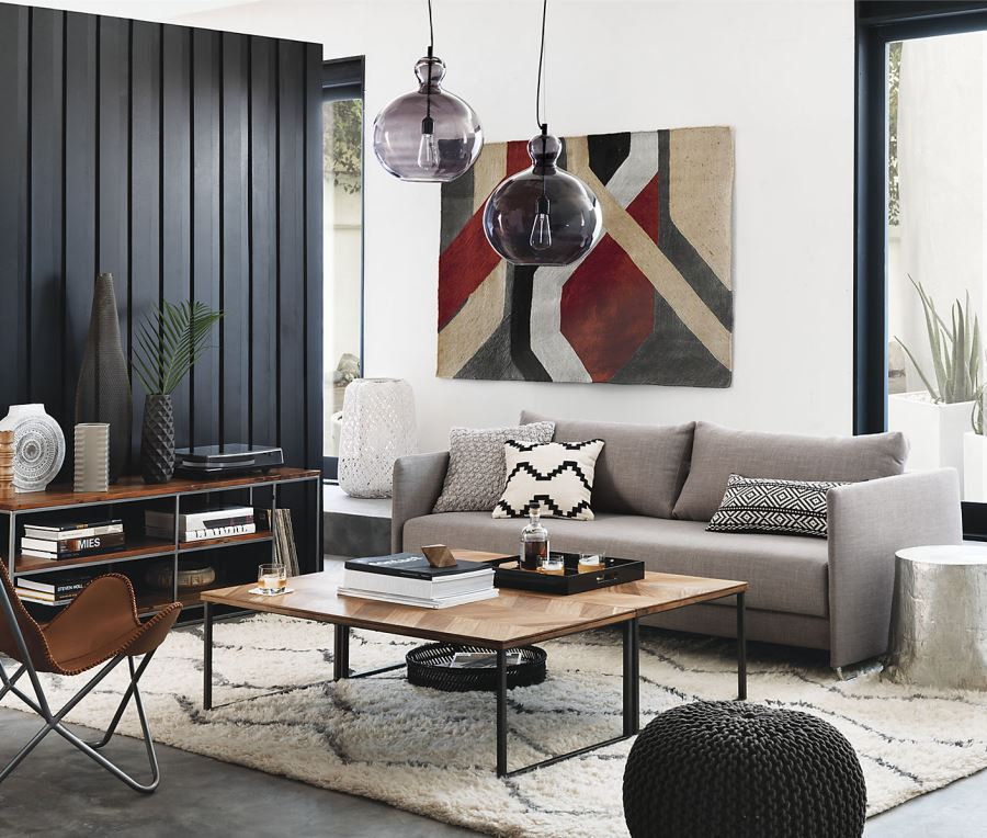View in gallery Black vertical wall paneling in a room designed by CB2 - 20 Rooms With Modern Wood Paneling