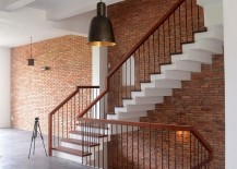 Brick draped staircase wall adds character to the interior