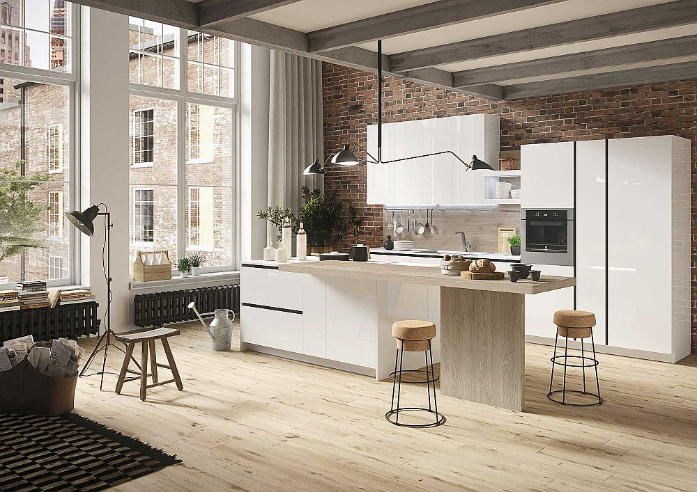 Brick wall in the backdrop adds textural beauty to the minimal kitchen