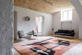 Chevron pattern ceiling and textured walls inside the Berlin apartment