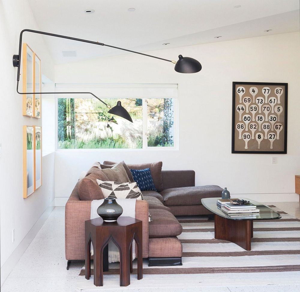 View in gallery comfy sectional and fun wall art for the media room in white · king residence in santa monica blends formal interiors with a striking facade