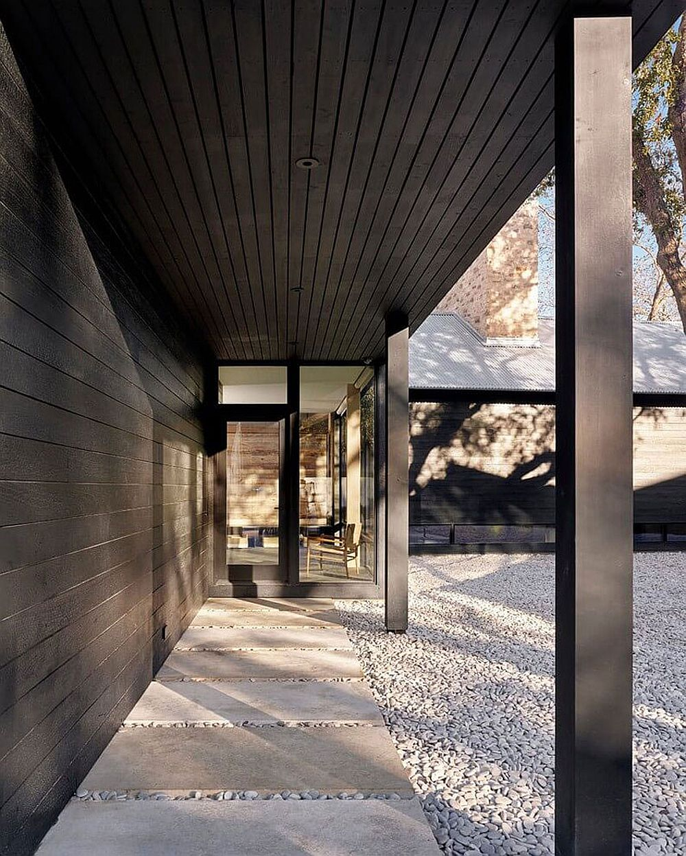 Covered walkway leads to the smart interior of the prefab home