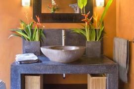 Cozy Balinese-inspired powder room design
