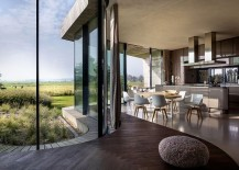 Curved-seat-along-with-the-kitchen-and-dining-area-inside-the-sustainable-dutch-home-217x155
