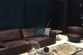 Dark leather sofas coupled with beautiful coffee tables and drum pendants