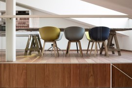 Dining room chairs bring a touch of color to the interior