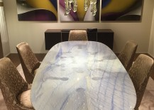 Dining-table-top-reflects-sparkle-of-the-chandelier-217x155