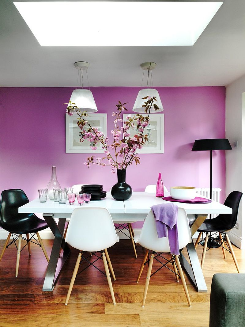 Exquisite dining room with purple walls offers a stunning backdrop for the Romeo Moon pendants [Design: Juliette Byrne]