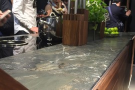 Fabulous kitchen island with stone worktop and wooden shelves - Team7 at EuroCucina