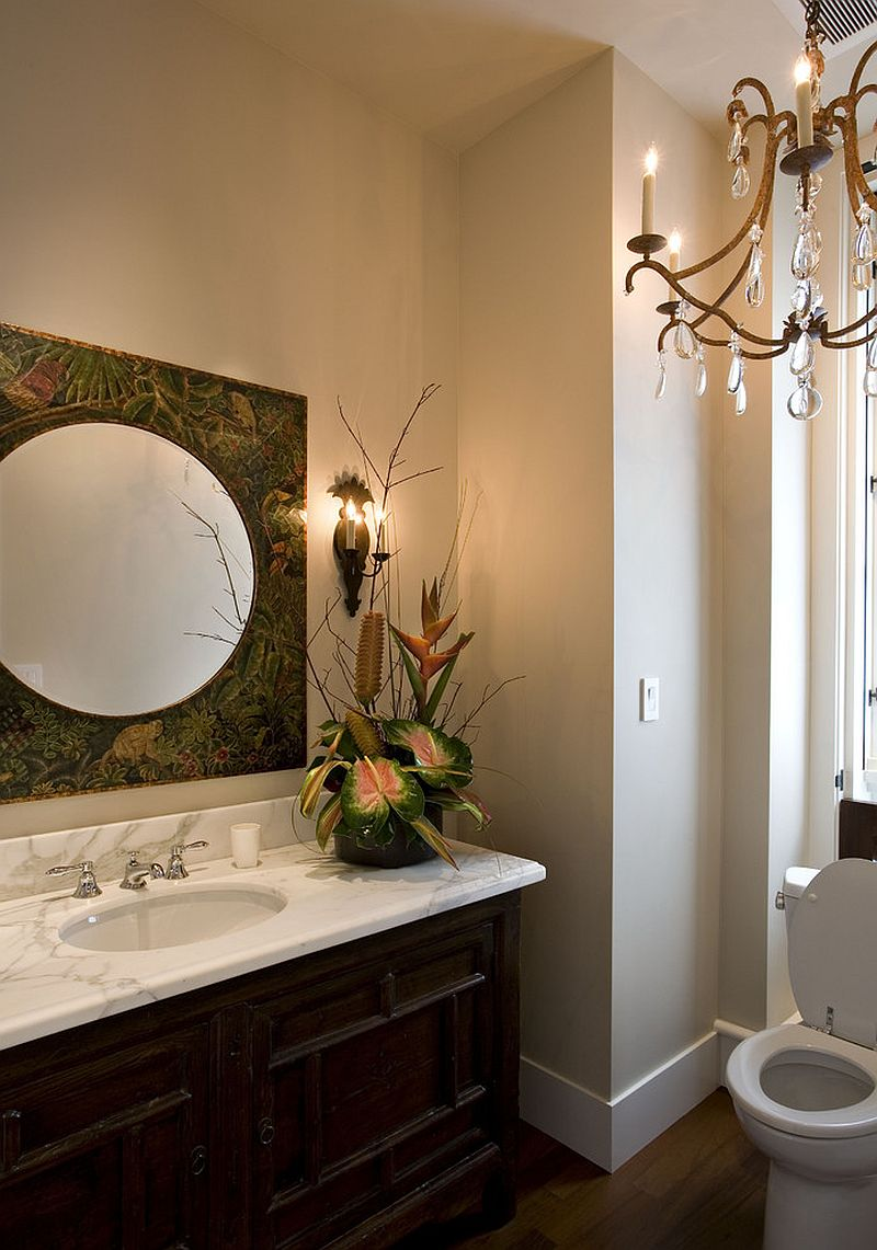 Fabulous mirror adds to the tropical theme of the powder room [Design: Sutton Suzuki Architects]