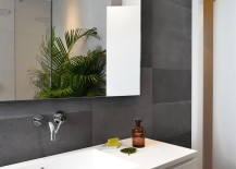 Fabulous modern bathroom with a white vanity