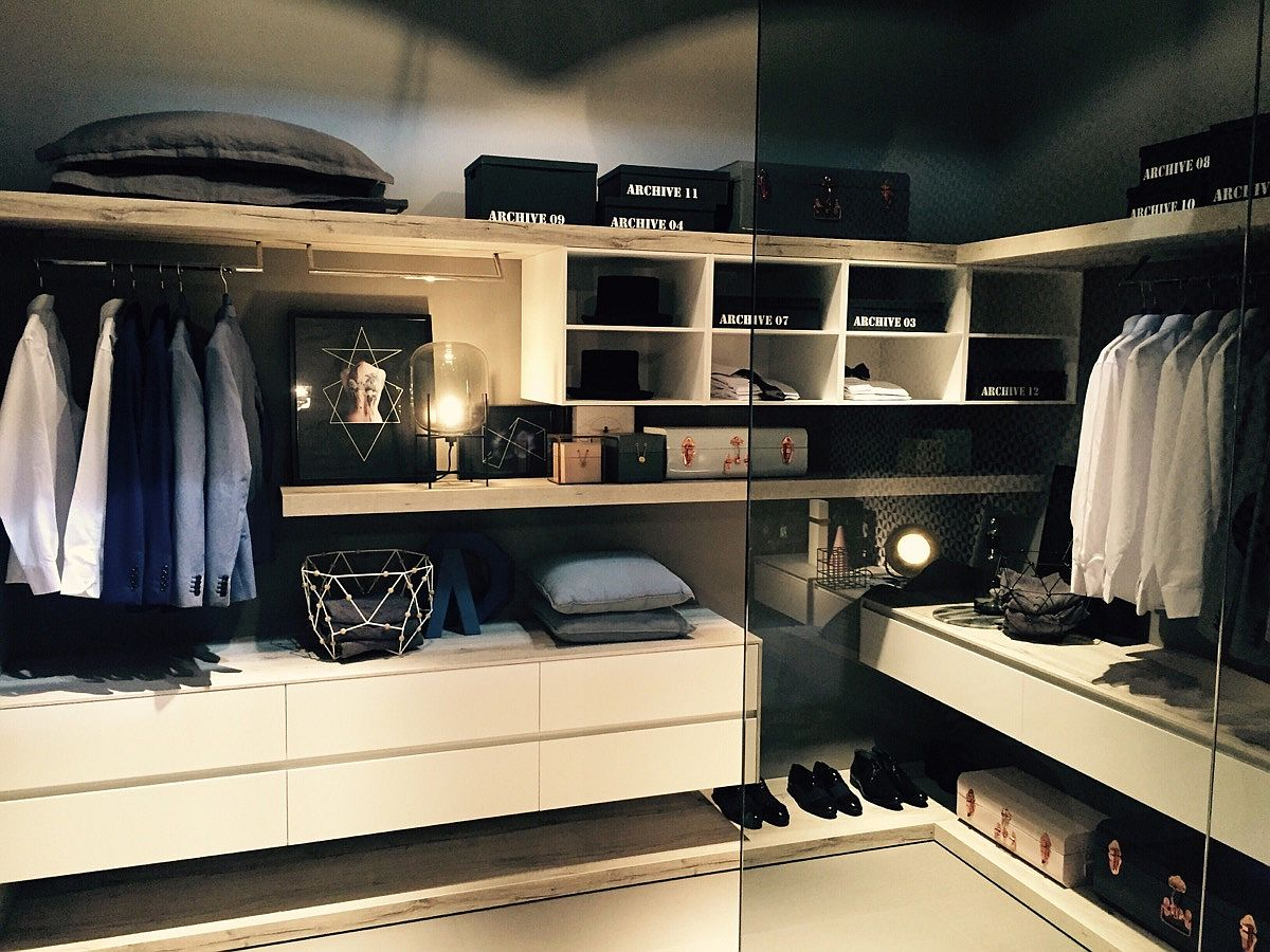 Fabulous walk-in closet acts as a design bridge between bathroom and bedroom