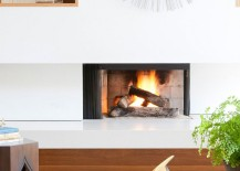 Fireplace inside the living room adds a cozy, contemporary focal point