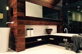 Flowing bathroom design draped in wood by Falper