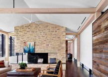 Gorgeous-living-room-of-Prefab-Austin-Home-with-stone-accent-wall-and-wooden-walls-217x155