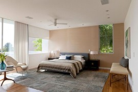 Grasscloth wallpaper brings an earthen vibe to the bedroom