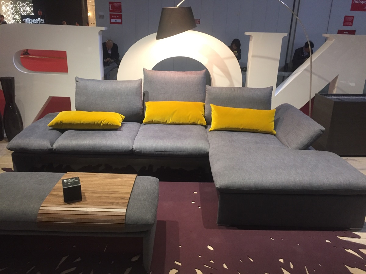 'Gray contemporary couch with yellow accent pillows – Koinor at iSaloni 2016