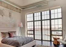 Industrial bedroom with the striking Rosy Angelis floor lamp