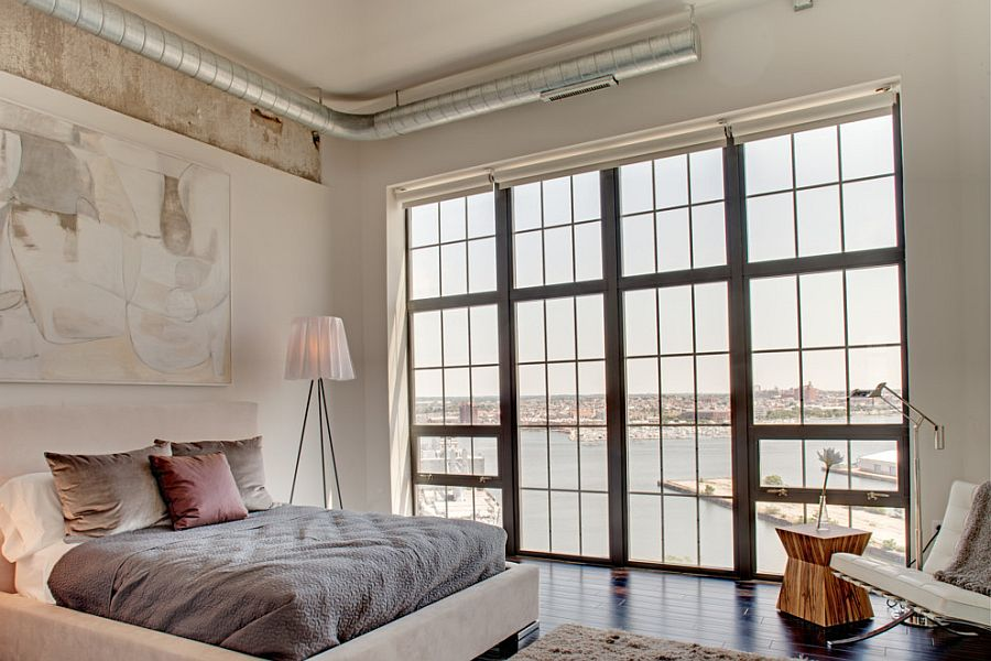 Industrial bedroom with the striking Rosy Angelis floor lamp [Design: Turner Development Group]