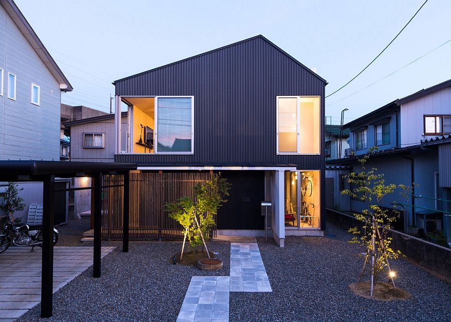 Landscape around the house and the extreior reflect a subtle industrial vibe Modern Industrial Japanese Home Redefines Boundaries of Style and Space
