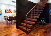 Large dark wooden panels contrast the warm tones of the floor 217x155 20 Rooms with Modern Wood Paneling
