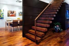 Large dark wooden panels contrast the warm tones of the floor