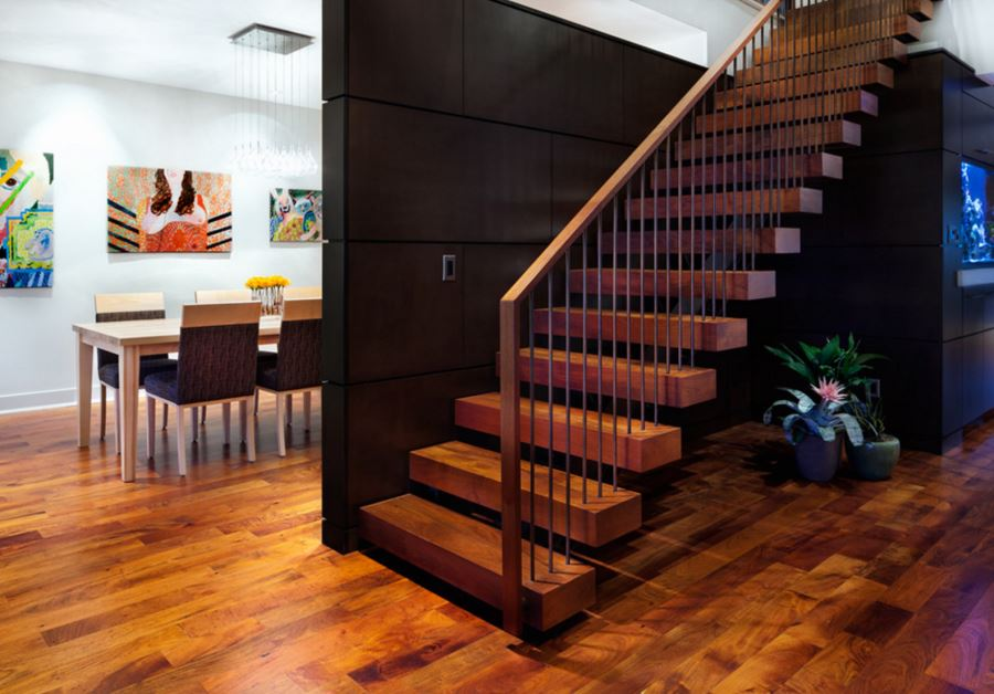 Large dark wooden panels contrast the warm tones of the floor