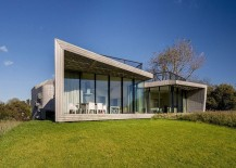 Large glass walls offer unabated views from the living area of the polder landscape 217x155 Step into This Smart Dutch House with Home Automation and Green Solutions!