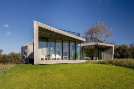 Large glass walls offer unabated views from the living area of the polder landscape
