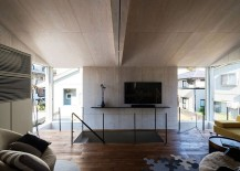 Large-windows-bring-in-natural-light-into-the-top-level-of-the-house-217x155