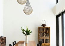 Lighting fixtures add a fun twist to the modern dining space