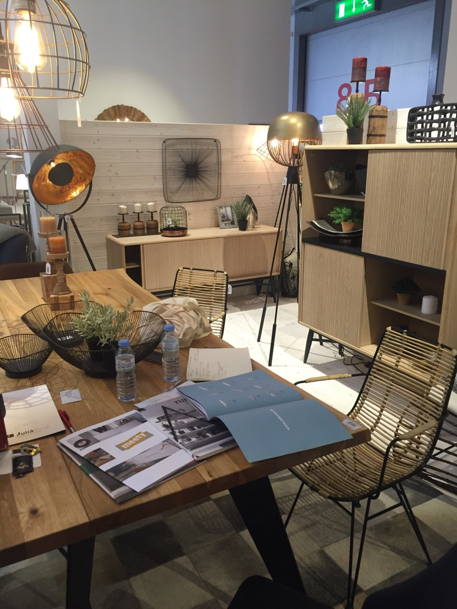 Lighting fixtures bring metallic glint to the La Forma stand in Milan