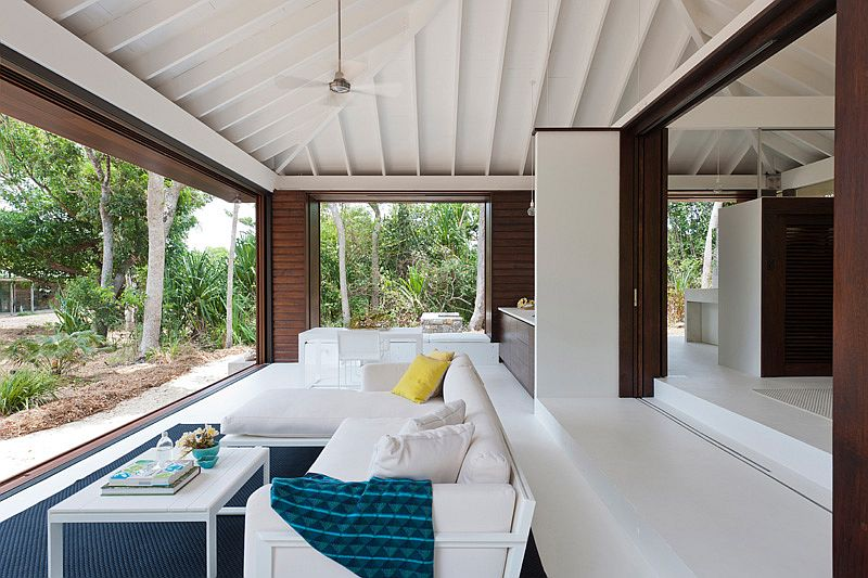 Small tropical style beach house opens up to the world outside for Small house design inside and outside