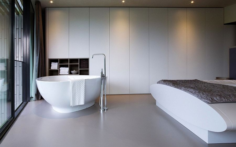 Minimal master bedroom in white with bathtub