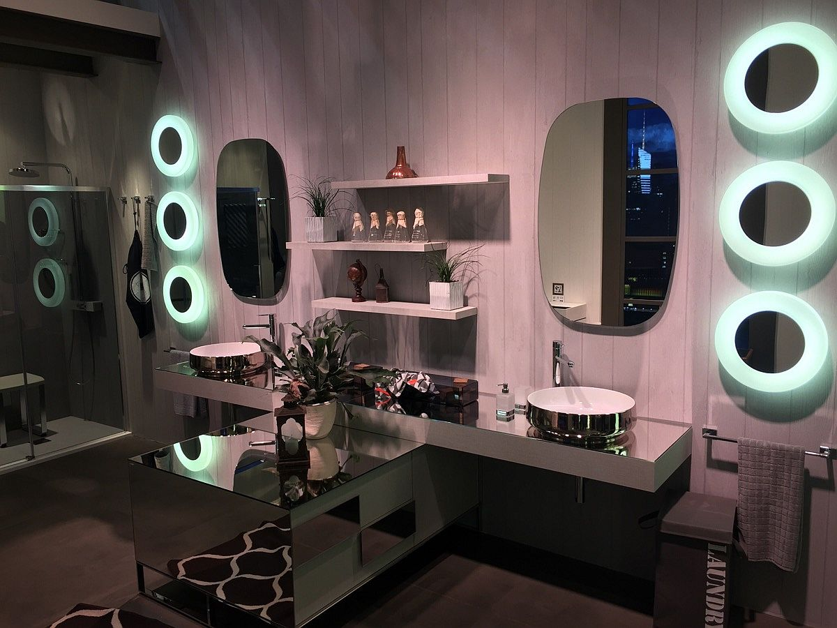 Mirror finishes and metallic sinks give inda bathrooms a dazzling aura