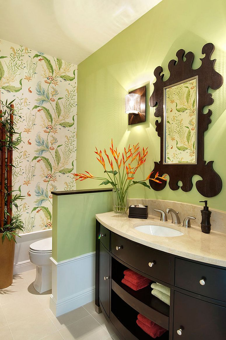 Mirror frame seems to complement the pattern of Thibaut wallpaper in the powder room [Design: Julians Interiors / Photography: Giovanni Photography]