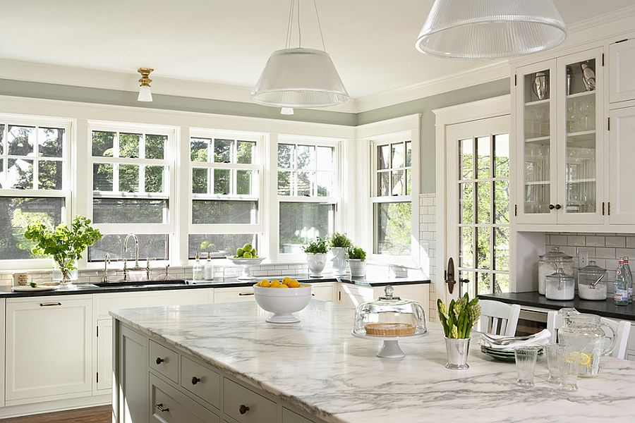 Modern pendants fit in seamlessly with the traditional backdrop of the kitchen [Design: Welch Forsman Associates]